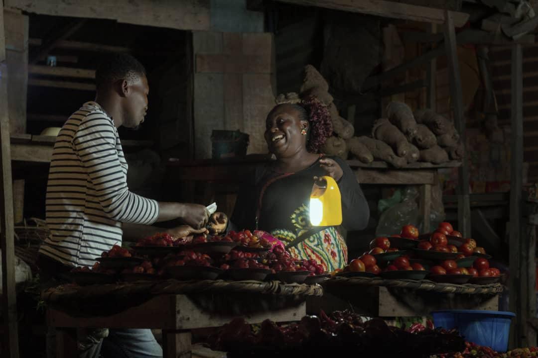 Market Woman / Trader using Salpha Bass Solar Home System
