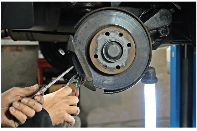 Mechanic at Work on Brake Disc